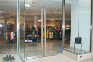 swinging frameless-glass doors