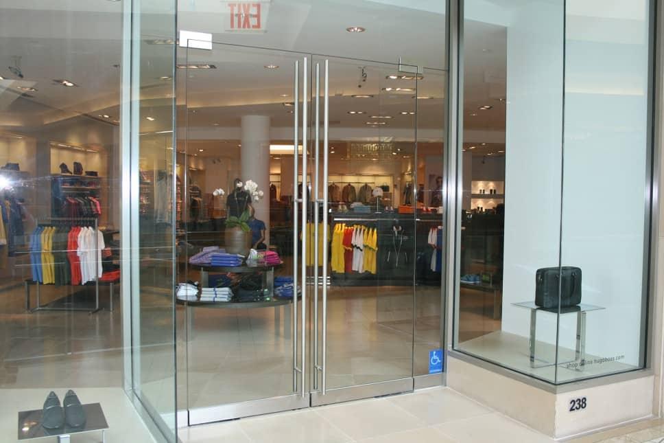 swinging frameless-glass doors
